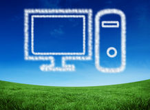 Composite image of cloud in shape of computer. Cloud in shape of computer against green field under blue sky Royalty Free Stock Image