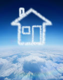 Composite image of cloud in shape of house Royalty Free Stock Photo