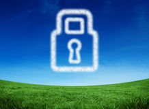 Composite image of cloud in shape of lock. Cloud in shape of lock against green field under blue sky Stock Photography