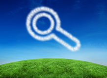Composite image of cloud in shape of magnifying glass Royalty Free Stock Photography