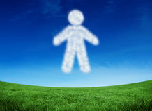 Composite image of cloud in shape of man. Cloud in shape of man against green field under blue sky Stock Photos