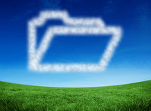Composite image of cloud in shape of open file. Cloud in shape of open file against green field under blue sky Stock Photography
