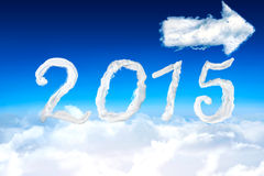 Composite image of 2015 in clouds. 2015 against cloud arrow and sky Royalty Free Stock Photos