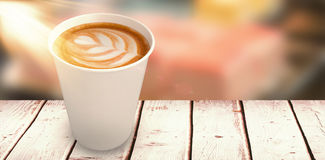 Composite image of coffee on white cup over white background Royalty Free Stock Image