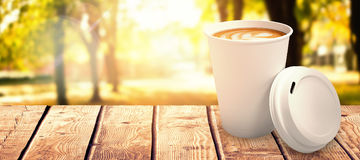 Composite image of coffee on white cup over white background Stock Image