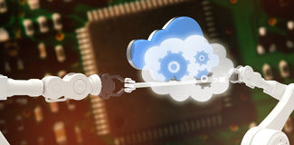 Composite image of cogs and wheels in cloud Stock Photo