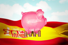 Composite image of coins and piggy bank Royalty Free Stock Image
