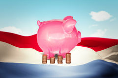 Composite image of coins and piggy bank Royalty Free Stock Photography