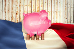 Composite image of coins and piggy bank Royalty Free Stock Photos