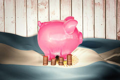 Composite image of coins and piggy bank Royalty Free Stock Images