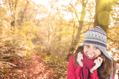 Composite image of cold redhead wearing coat and hat Stock Images