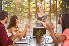 Composite image of colleagues clapping hands in a meeting Royalty Free Stock Photography