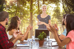 Composite image of colleagues clapping hands in a meeting Royalty Free Stock Photos
