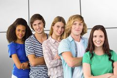 Composite image of college students arms crossed. College students arms crossed against white tiling Royalty Free Stock Photography