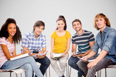 Composite image of college students doing homework Royalty Free Stock Photo