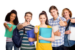 Composite image of college students gesturing thumbs up Stock Photo
