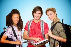 Composite image of college students reading book in library. College students reading book in library against blue background with vignette Royalty Free Stock Images