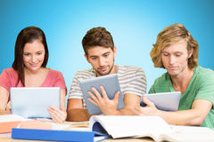 Composite image of college students using digital tablets in library Stock Photography