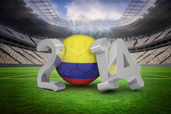Composite image of colombia world cup 2014 message. Colombia world cup 2014 message against vast football stadium with fans in white Royalty Free Stock Image