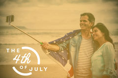 Composite image of colorful happy 4th of july text against white background. Colorful happy 4th of july text against white background against happy couple with Stock Illustration