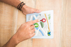 Composite image of colorful navigation pointers with various representations on map Stock Photo