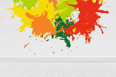 Composite image of colourful paint splashes. Colourful paint splashes against gray flooring and wall Royalty Free Stock Photo