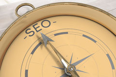Composite image of compass pointing to seo Stock Image