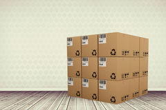 Composite image of composite image of cardboard boxes. Composite image of cardboard boxes against room with wooden floor Royalty Free Stock Photography