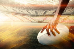 Composite image of composite image of cropped image of athlete holding rugby ball 3d Royalty Free Stock Image