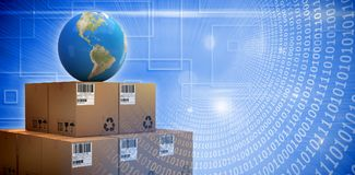 Composite image of composite image of globe on cardboard boxes Royalty Free Stock Images