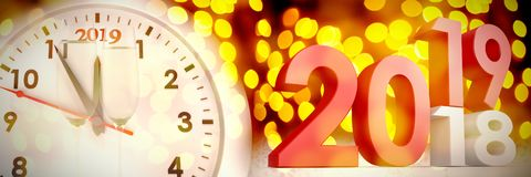 Composite image of composite image of numbers changing from old to new year. Composite image of numbers changing from old to new year against unfocused yellow vector illustration