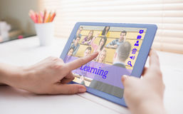 Composite image of composite image of online courses. Composite image of online courses against cropped image of person using on digital tablet Stock Photography