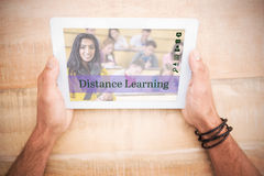 Composite image of composite image of online courses. Composite image of online courses against hands holding blank screen tablet Stock Images