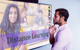 Composite image of composite image of online courses. Composite image of online courses against thoughtful men looking over whiteboard Royalty Free Stock Photography