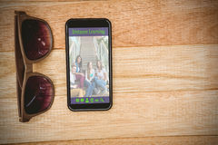 Composite image of composite image of online courses. Composite image of online courses against view of glasses and a smartphone Royalty Free Stock Photography