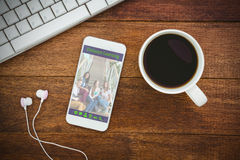 Composite image of composite image of online courses. Composite image of online courses against view of a mug of coffee and a smartphone Royalty Free Stock Photography