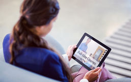 Composite image of composite image of online courses. Composite image of online courses against women using digital tablet Stock Photography