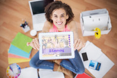 Composite image of composite image of online courses. Composite image of online courses against young creative businesswoman showing her tablet Royalty Free Stock Photo