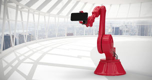 Composite image of composite image of red robot with smart phone 3d Royalty Free Stock Photos