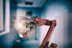 Composite image of composite image of red robotic arm holding light bulb 3d Royalty Free Stock Photography