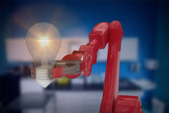 Composite image of composite image of robotic arm holding light bulb 3d Stock Photo