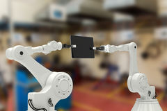 Composite image of composite image of robots holding computer tablet 3d Stock Photo
