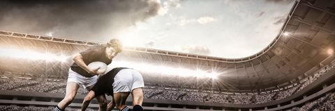 Composite image of composite image of sport arena with supporter. Composite image of sport arena with supporter against rugby players tackling during game royalty free stock images