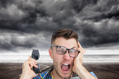 Composite image of computer engineer screaming while on call in front of open cpu Stock Image