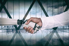 Composite image of computer graphic image of businessman and robot shaking hands Stock Photos