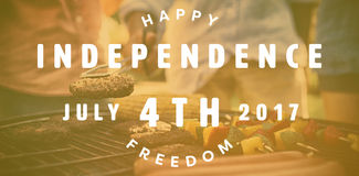Composite image of computer graphic image of happy 4th of july text. Computer graphic image of happy 4th of july text against men barbecuing in family Royalty Free Illustration