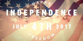 Composite image of computer graphic image of happy 4th of july text. Computer graphic image of happy 4th of july text against view of snowy mountain range and Royalty Free Stock Photos