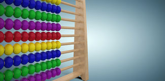 Composite image of computer graphic image of toy abacus. Computer graphic image of toy abacus against grey vignette Royalty Free Stock Photo