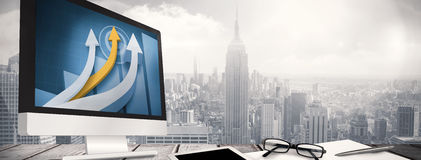 Composite image of computer screen. Computer screen against room with large window looking on city Royalty Free Stock Image