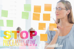 Composite image of concentrated artist looking at colorful sticky notes Royalty Free Stock Image